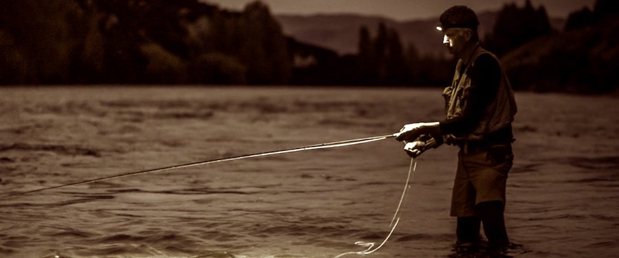 Salmon fishing on river with a Petzl headlamp.